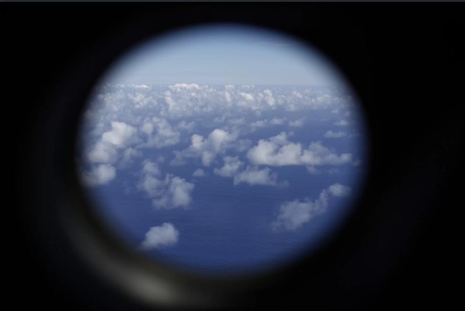 Một chiếc máy bay tuần thám P-3K2 Orion của Không lực New Zealand tìm kiếm dấu vết của MH370 trên khu vực phía Nam Ấn Độ Dương. Ảnh: Jason Reed-Pool/Getty Images