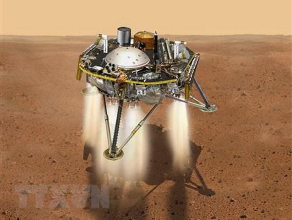 Hình ảnh mô phỏng Tàu thăm dò sao Hỏa InSight đổ bộ xuống bề mặt sao Hỏa. (Ảnh: AFP/TTXVN)
