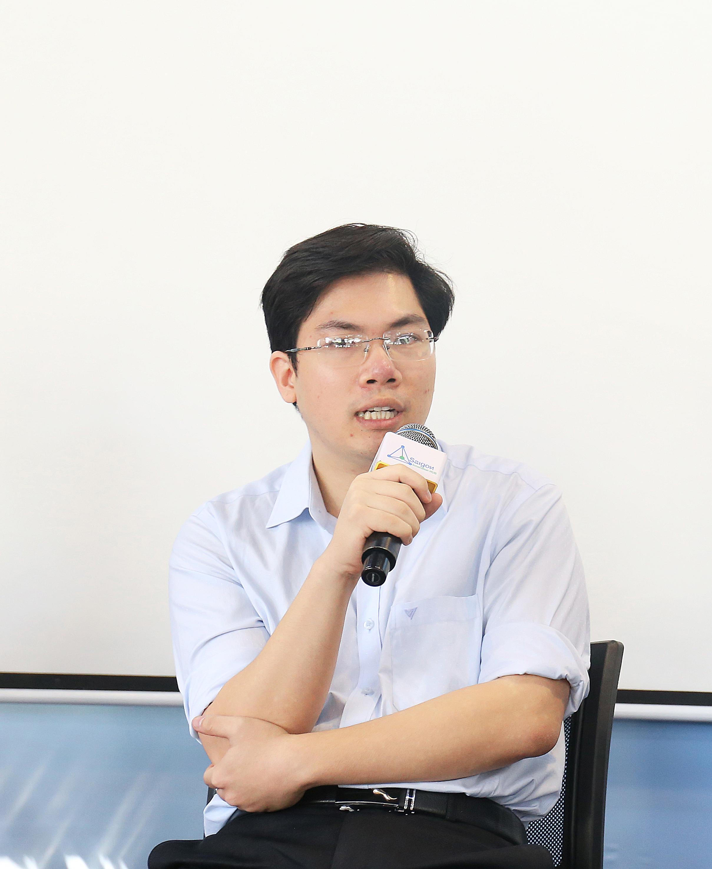 Anh Phạm Nam Long trong một hội thảo do Báo KH&PT/Ấn phẩm Tia Sáng tổ chức.