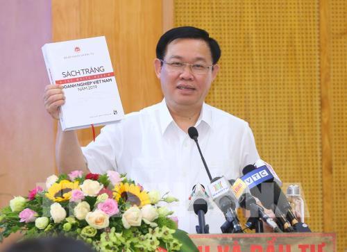 Phó Thủ tướng Vương Đình Huệ công bố Sách trắng doanh nghiệp Việt Nam năm 2019. Ảnh: Doãn Tấn/TTXVN
