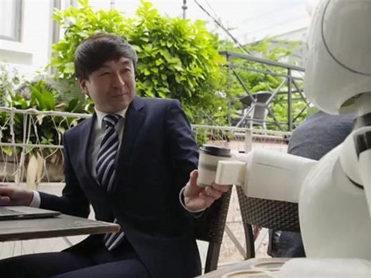 Robot giúp người bại liệt làm việc tại quán cafe ở Nhật